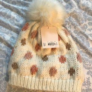 Lauren Conway knit polkadot hat with pom-pom ball